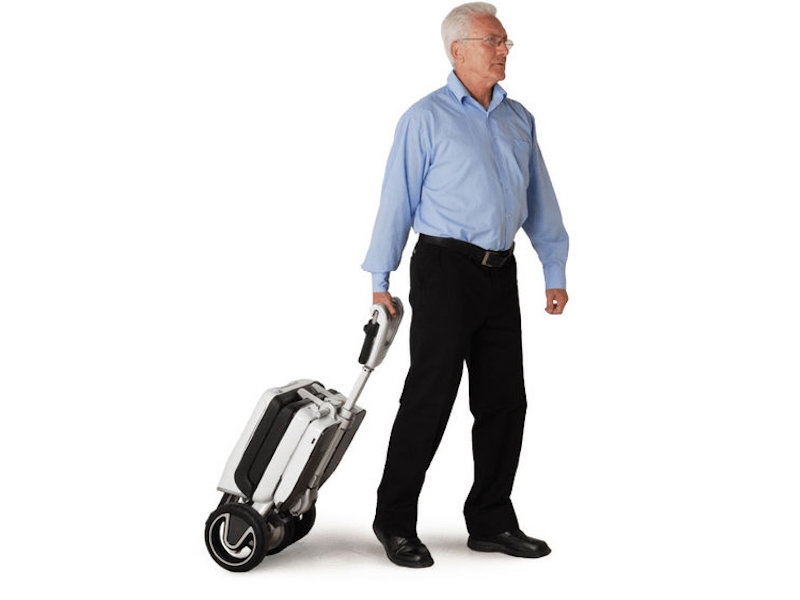 Man pulling an ATTO foldable scooter