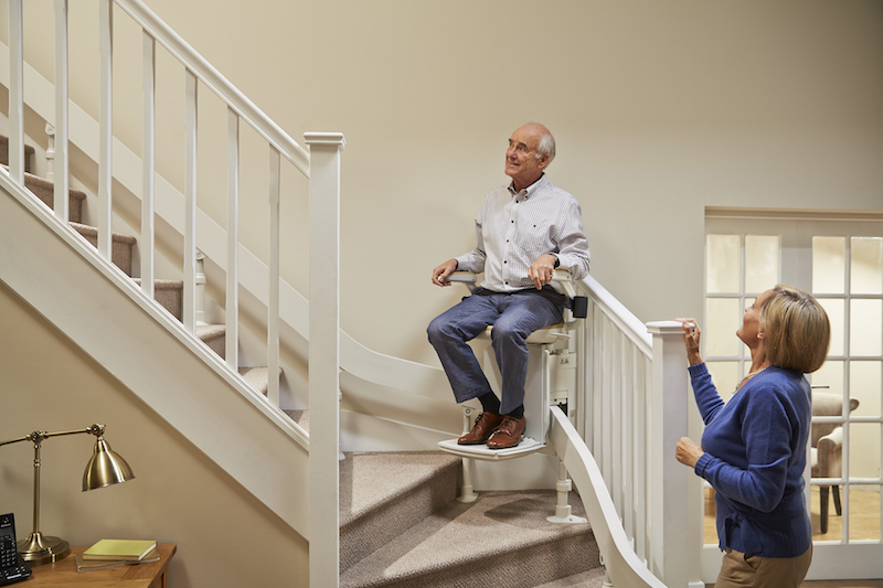 A couple using a Acorn stairlift